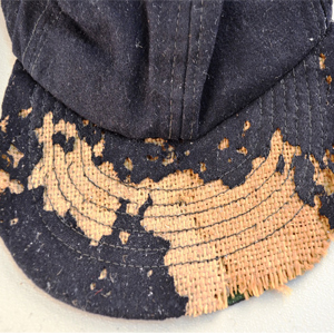 Damage to cap from clothes moths